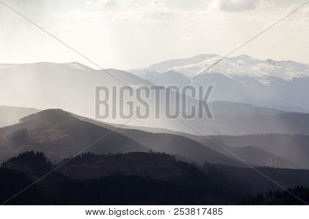 Breathtaking View Of Magnificent Foggy Carpathian Mountains, Covered With Ever-green Forest On Misty