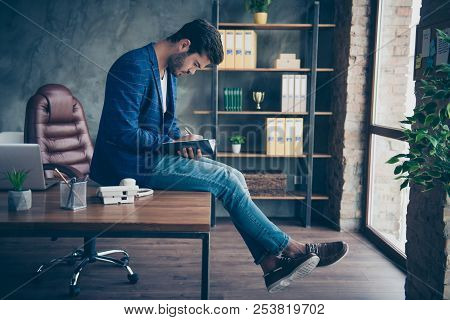 Attractive Handsome Young Brunet Bearded Serious Executive Worker Man In Office Workstation Workplac