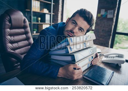 Bureaucratic Tasks Of The Assistant. Heavy Head Of A Man Lies On A Pile Of Papers That Must Be Carri