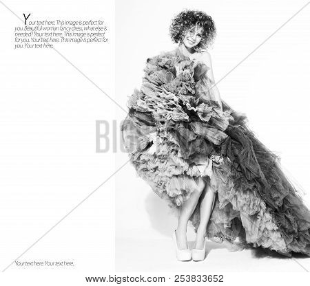 Contrast Black And White Portrait Of Sexy Youngl Woman Posing In Long Dress On The White Background