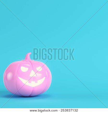 Pink Halloween Pumpkin, Jack O Lantern On Bright Blue Background In Pastel Colors. Minimalism Concep