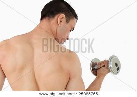 Sporty male doing weight lifting against a white background