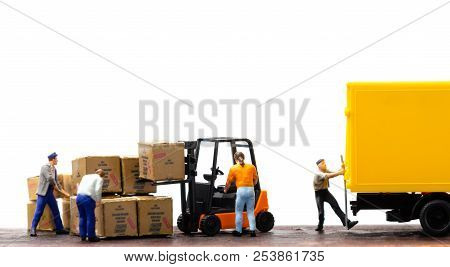Miniature Warehouse Workers Forklift Carrying Goods Box To Semi Truck With Trailer .logistics Wareho