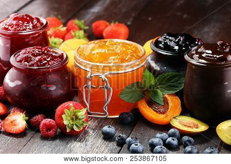 assortment of jams, seasonal berries, apricot, mint and fruits. marmalade or confiture poster