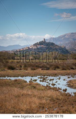 Cityscape Of The Old Town Of Posada With Castello Della Fava On The Italian Island Of Sardinia