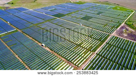 Solar Panel Farm Providing Clean Renewable Energy For Austin , Texas - Green Summer Time Grass With