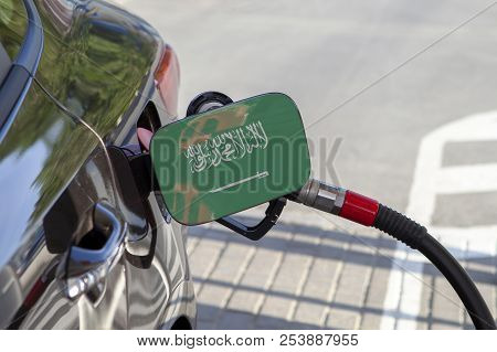 Fueling Car With Petrol Pump At A Gas Station.