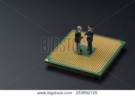 Deal, Agreement Or Business Teamwork Or Merger Of It Company, Miniature People Figure Businessmen Ha