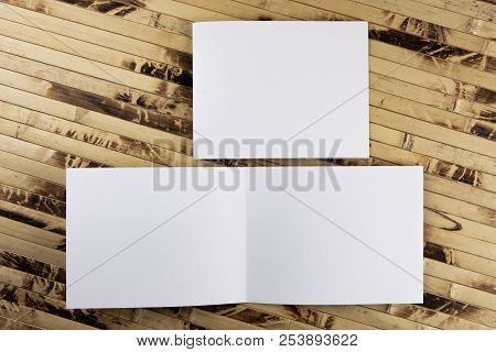 Mockup Of White Booklet On Bamboo Background