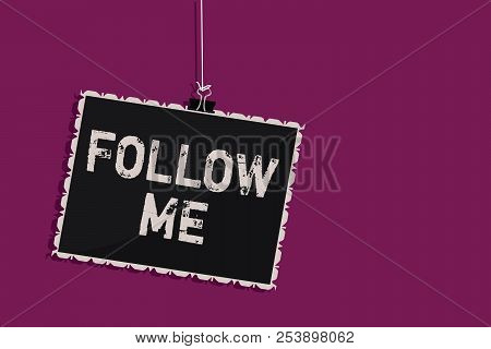 Word writing text Follow Me. Business concept for Inviting a person or group to obey your prefered leadership Hanging blackboard message communication information sign purple background. poster