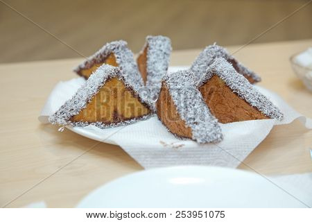 Three-pointed White Cake And Cake With Chocolate. Coconut Cake On White Plate. Cremeschnitte Cake On