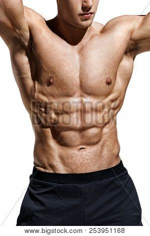 Close Up Of Man Showing Muscular Body And Six Pack Abs. Photo Of Man Shirtless On White Background.