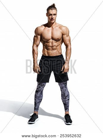 Muscular Man. Photo Of Handsome Man With Perfect Physique After Training Isolated On White Backgroun