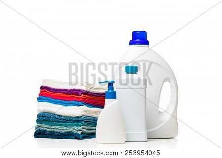 Photo of three bottles of cleansers and colorful towels