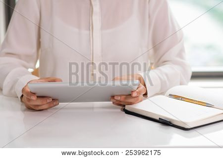 Unidentified Office Employee Working With Touchpad. Closeup Of Female In Formal Blouse Using Tablet