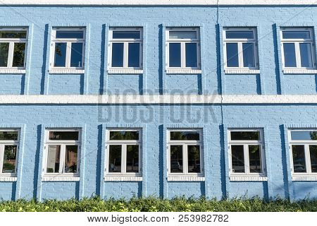 Blue Brick House With White Windows Side By Side