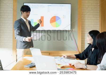 Man Presentation To His Colleagues During A Meeting Or In Office Business Training. Business Team Me