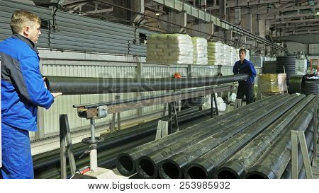 Russia, Angarsk - June 8, 2018: Sawmill Circular Saw Machine. Manufacture Of Plastic Water Pipes Fac