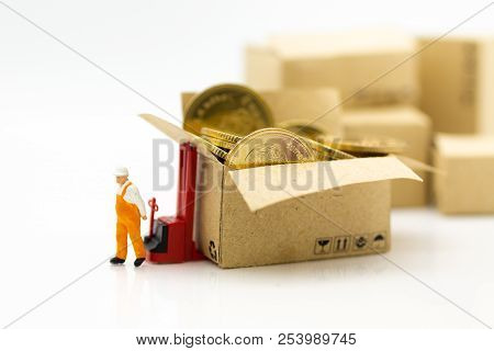 Miniature People: Worker Use Pallet Truck With Stack Of Coins. Image Use For Background Business Con