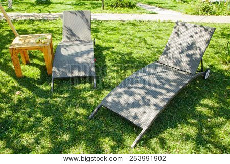 Two Deckchairs On The Green Grass In The Garden On A Summer Sunny Day In The Shade. View From Above.