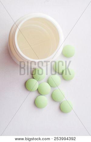 Medication Pills. White Pills, White Background. A Jar Of Pills