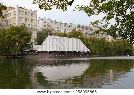 Moscow, Russia - August 15, 2018: Buildings And Tent Restaurant On Chistye Prudy Pond Shore. Chistye