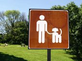 A notice in a park advising people must have dogs on a lead poster