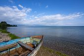 Lake Ohrid landscapes and Boat washed on beach in Macedonia poster