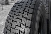 Protector of automobile tires. A number of automobile tires. Close up view on auto mobile new wheel tire surface. Different pattern and type tires for car industry commercial transport transpotration. poster