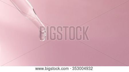 A Dropping Pipet, Pipette, Medicine Dropper, Dropping With Transparent Liquid Or Fluid, On Pink Back