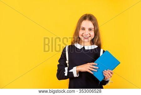 First Day Of School. Happy Schoolgirl Yellow Background. Little Schoolgirl Back To School. Small Sch