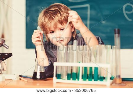 Boy Test Tubes Colorful Liquids Chemistry School Classroom. Kid Study Chemistry. Biotechnology And P
