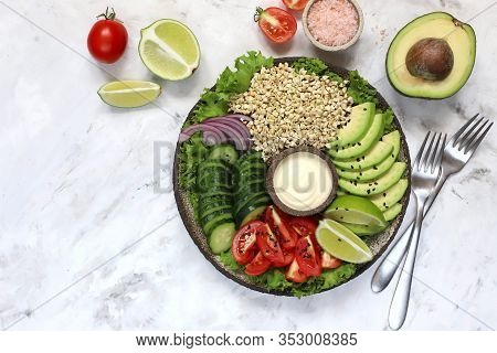 Healthy Salad With Green Buckwheat, Avocado, Cucumber, Tomato. Top View