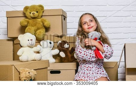 Girl Small Child And Boxes. Prepare For Moving. Rent House. Real Estate. Dreaming About Own Room. Mo