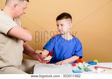 Health Care. Medical Examination. Boy Cute Child And His Father Doctor. Hospital Worker. Medical Hel