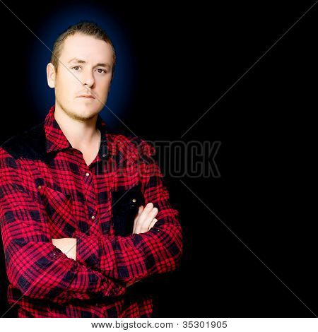 Serious Male Worker On Dark Blue Background