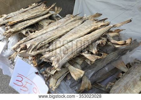 Dried Headless Stockfish Dried In The Sun For Sale In The Stall At The Market