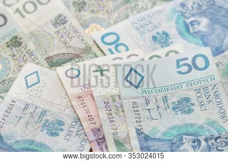 Pln Banknotes With Denominations Of 20, 50 And 100 Pln Lie On The Table.