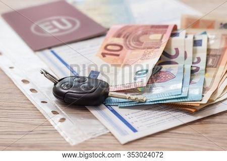 Car Sale. The Car Keys Lie On The Table Along With Euro Documents And Money.