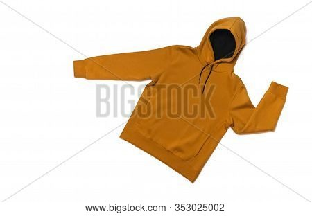 Yellow Fashionable Men's Sweatshirt With A Hood On White Background Top View. Fashionable Male Cloth
