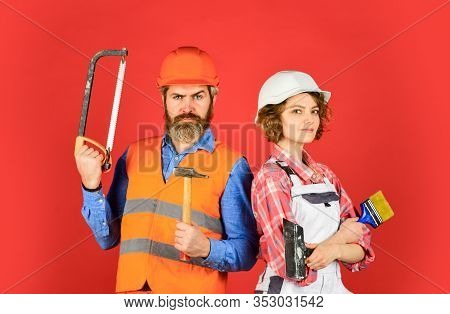 Couple Is Renovating Home. Couple Doing Apartment Repair Together Themselves. Man And Woman Wear Saf