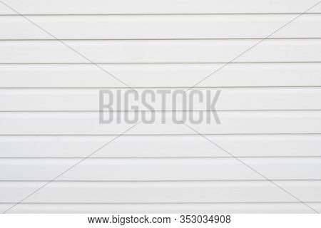 White construction vinyl siding panels as background