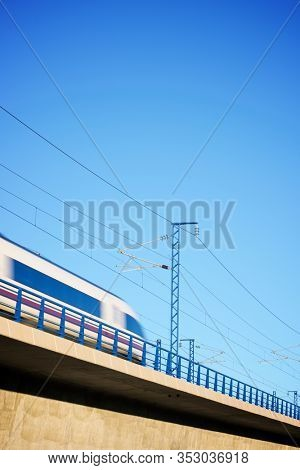 View of a high-speed train crossing a viaduct in Zaragoza, Aragon in Spain. AVE Madrid Barcelona.