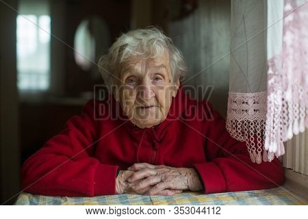 Granny. Portrait of an elderly gray-haired woman.