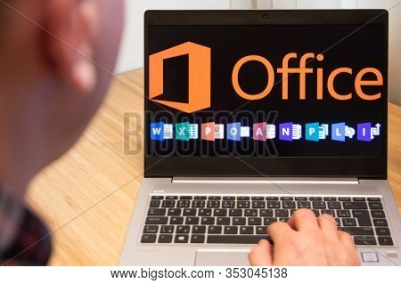 Office 365 Is Used By A Man On The Laptop. Microsoft Customer Used Computer Software. New Product Is