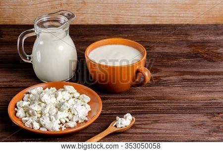Homemade Fermented Milk Products - Kefir, Cottage Cheese On A Wooden Background. Healthy Food Concep