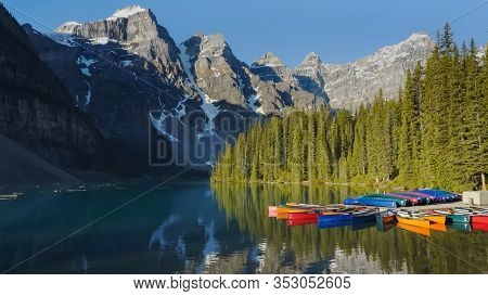 Shot Of Moraine Lake And Canoes At A Dock In Banff National Park