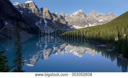 Early Morning View Of Reflections On Moraine Lake In Banff Np, Canada