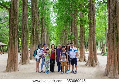 Chuncheon, South Korea - June 08, 2018:happy Family Group Photo At The Tree-lined Trails Of Nami Isl