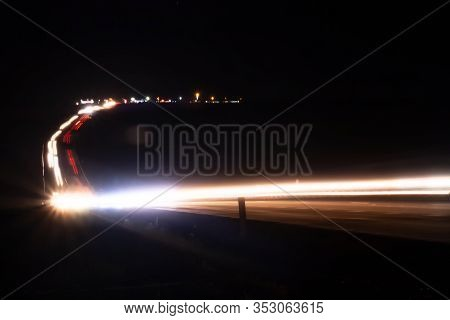 Abstract Image With Blurry Car Fragments On A Speedway.the Cars Moves At Fast Speed At The Night. Bl